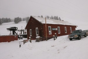 The lodge with the chairlift in the background